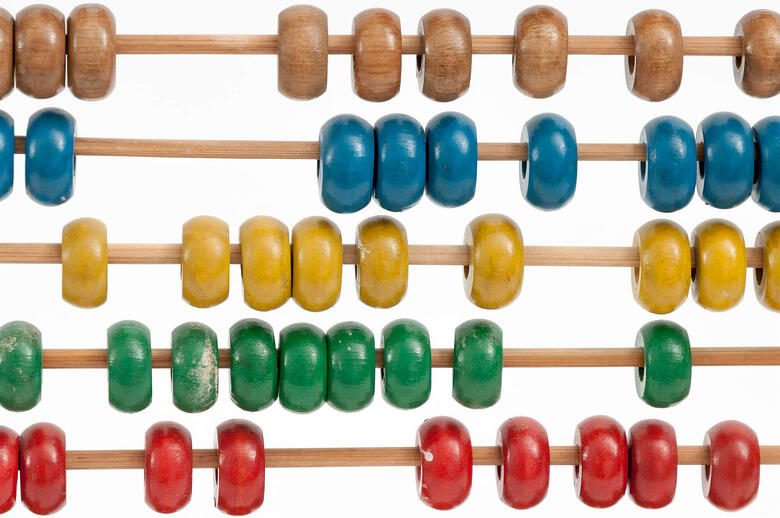An abacus highlighting a manual way for counting people
