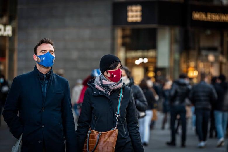 Pedestrians wearing masks