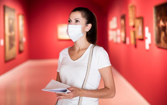 A visitor at a gallery wearing a mask during the pandemic
