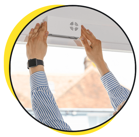 The easy, self-install HoxtonAi overhead people counting sensor being installed.
